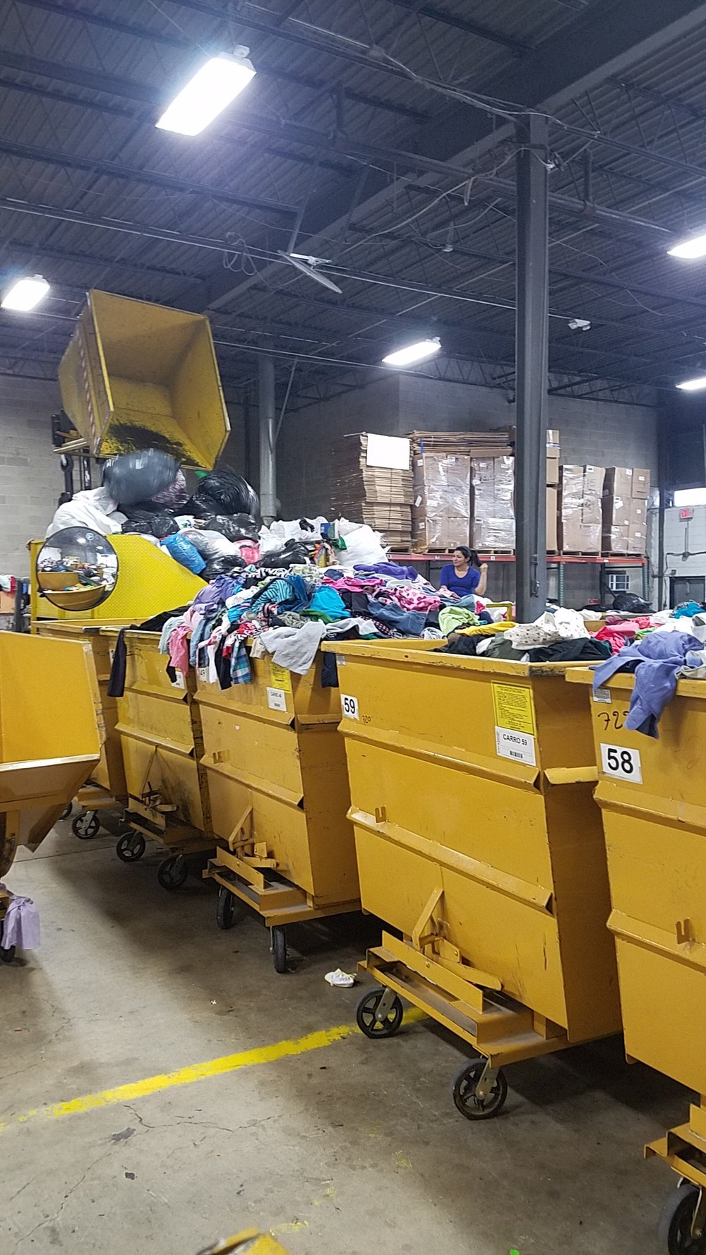 Collected clothing at a sorting facility