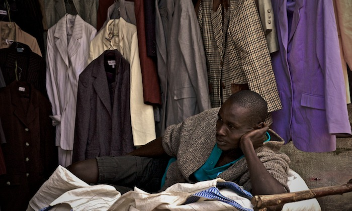 A secondhand clothing salesman at a market in Nairobi, Kenya. Image by Colin Crowley  via Flickr .