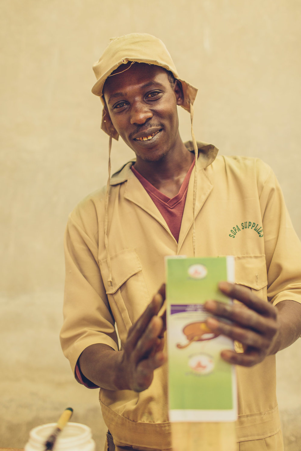 An employee at Sopa Foods, a maize processing company working with Partners in Food Solutions volunteers. Image courtesy of Partners in Food Solutions.