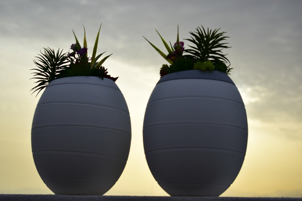 Two memorial urns at sunset. Image by Inzein Urns via Pixabay
