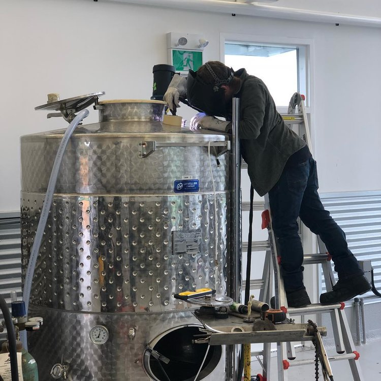 A welder working on a fermenter tank at Dairy Distillery. Image courtesy of Dairy Distillery