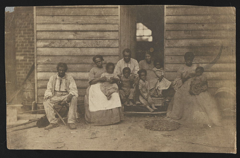 """""""Family of slaves at the Gaines' house ,"""" 1862. Photo via Library of Congress"""