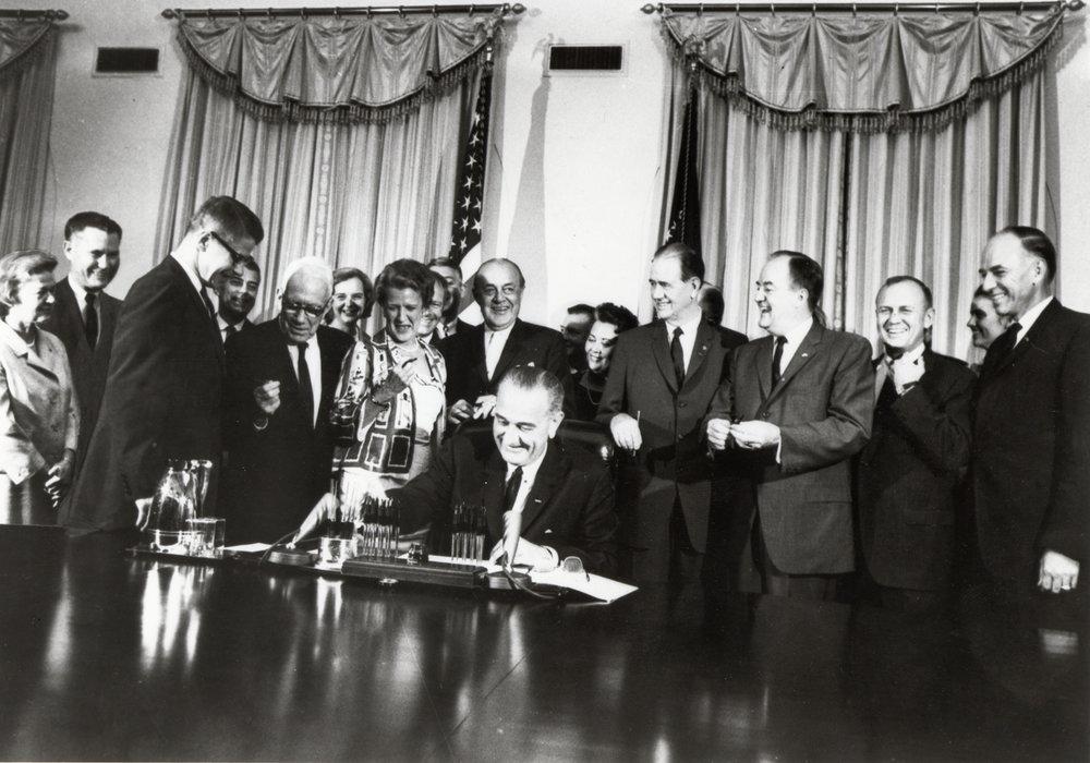 U .S. President Lyndon B. Johnson signing the Food Stamp Act of 1964. Photo via USDA