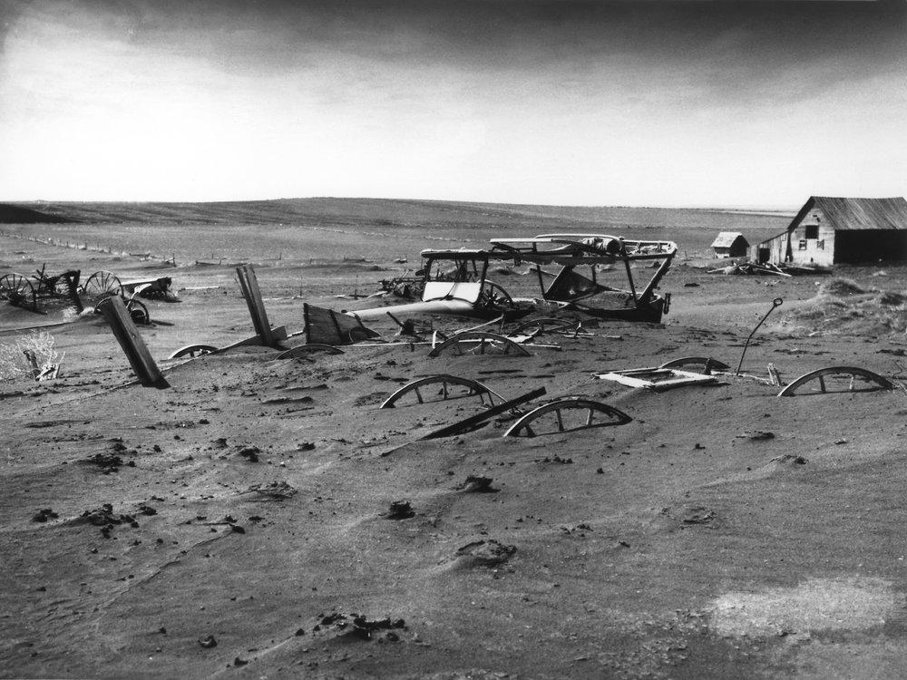 Buried machinery in a barn lot in Dallas, South Dakota. May 1936. Photo via Wikipedia/USDA