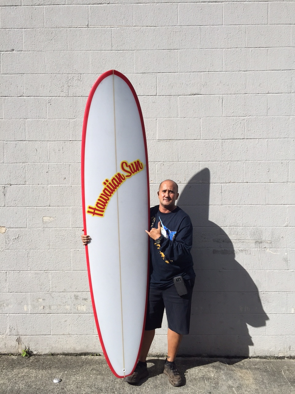 Joe Ng, winner of the Hawaiian Sun surfboard