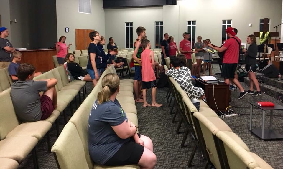 On the last night of our trip, singing worship together.