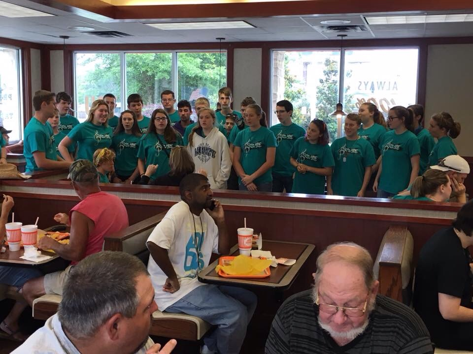Our students singing in a Whataburger in the panhandle of FL.