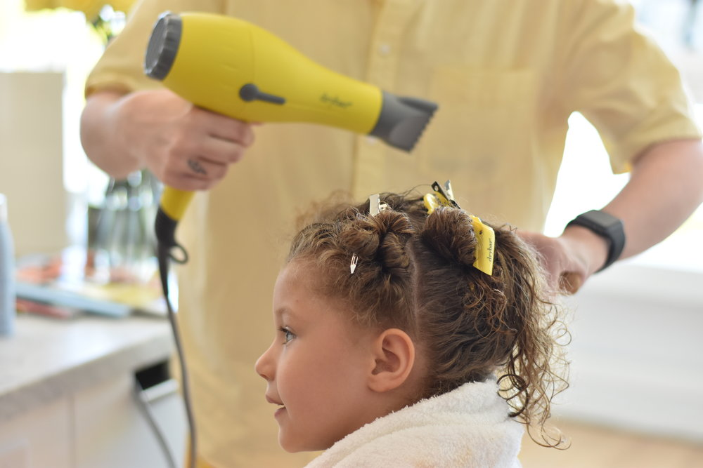 Image of girl getting a blowout style at DryBar salon in Indianapolis.