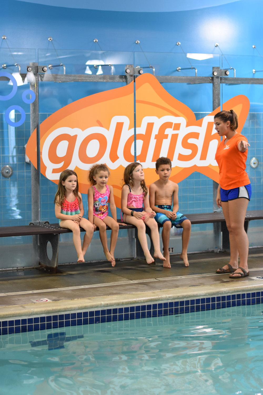 A Goldfish Swim School instructor giving the kids a lesson in water safety.