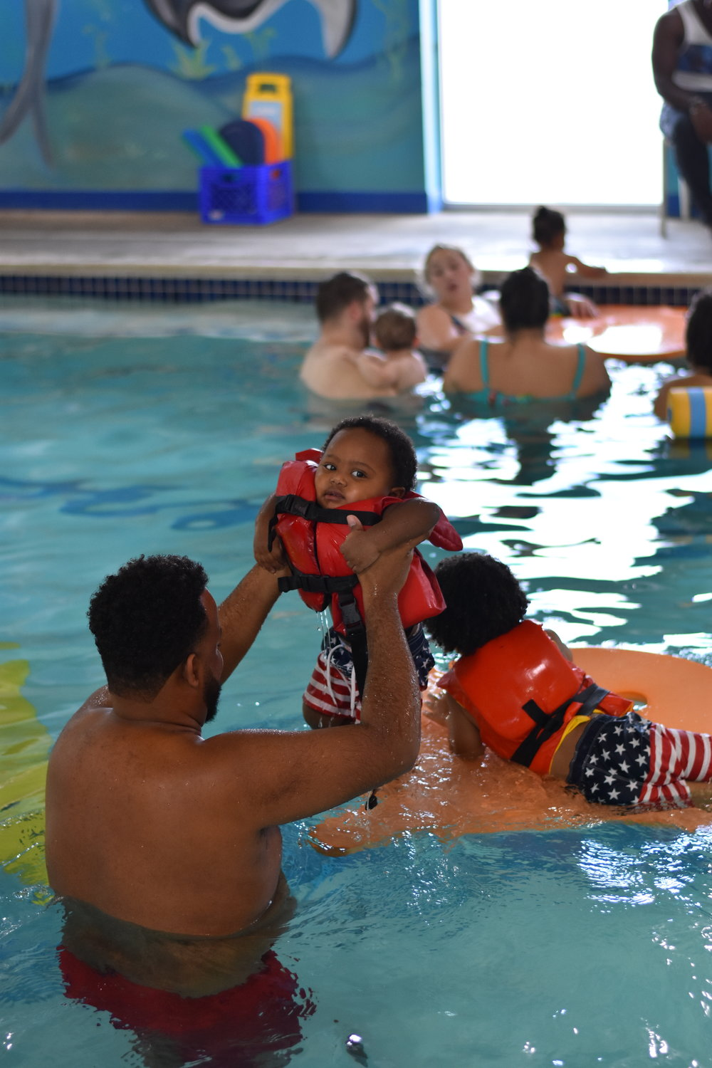 For safety, at least one parent needs to be in the water with a child during Family Swim events.