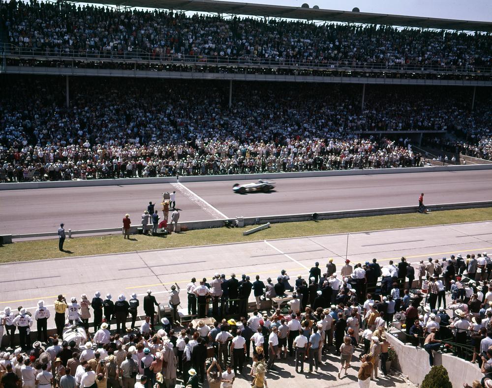 1963-Parnelli-Jones-taking-checkered-flag.jpg
