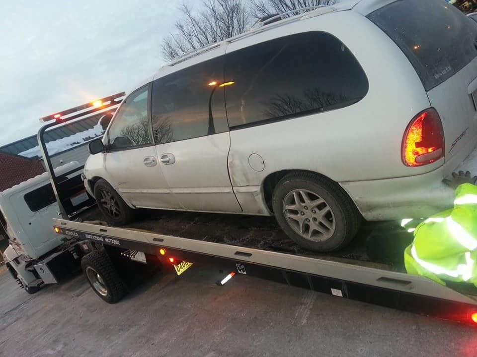 My Dodge Caravan after the AAA driver hoisted it up to tow