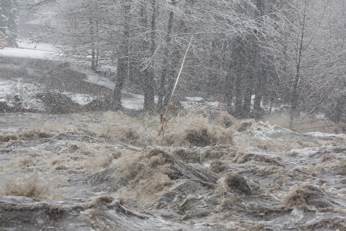 Waves surging onto the land during a storm is known as coastal flooding