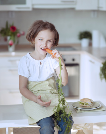 Eating carrots is good for your hair. Getty Images