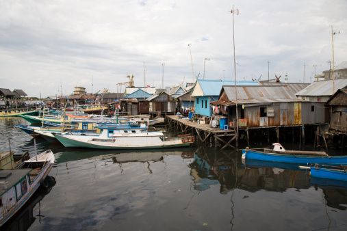 In this fishing village the houses are built over the water on stilts. iStock
