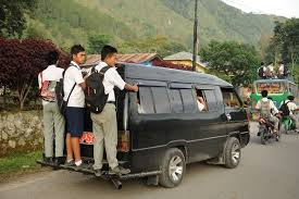 These students take buses (riding on top!) and mini taxis to school