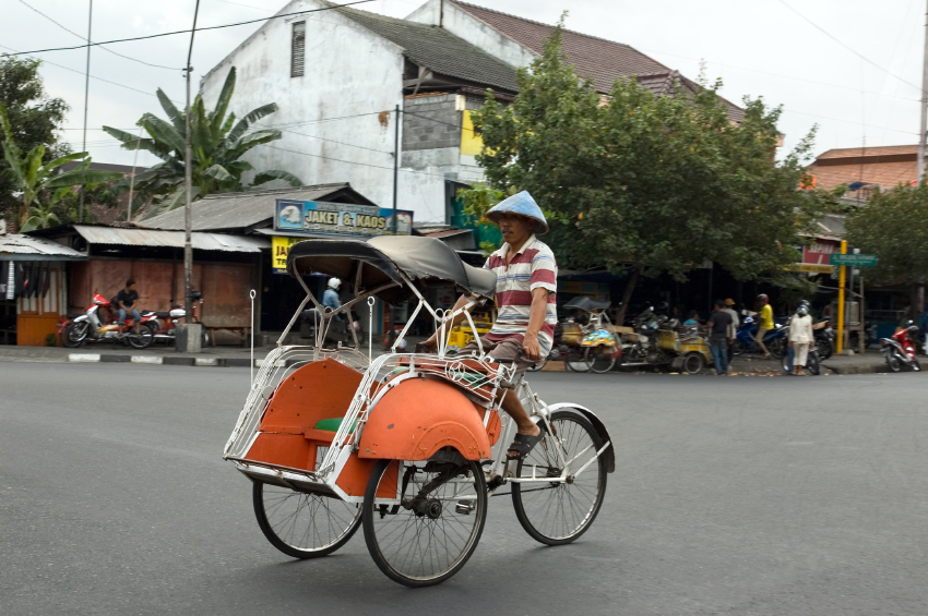 This 3 wheeled vehicle is called a becak (say bee-chack). It carries one or two passengers