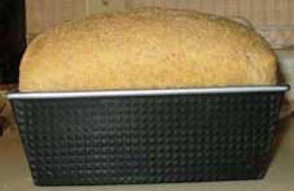 A loaf of bread ready to take out of the oven. Getty