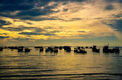 Vietnamese fishing boats at dawn. Photo©iStock