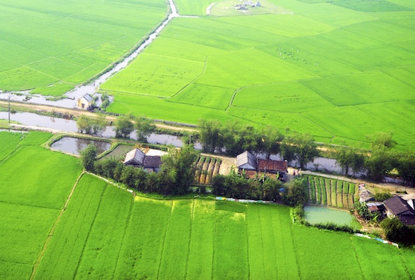 Small farming village along a canal. Image©iStock