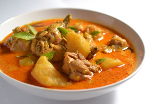 Indonesian food is spicy. This is chicken curry and it will be served with rice. © iStock