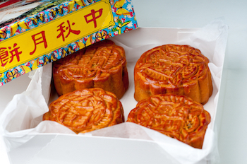 Moon Cakes are filled with nuts, sweet beans and dried fruit. © Getty Images