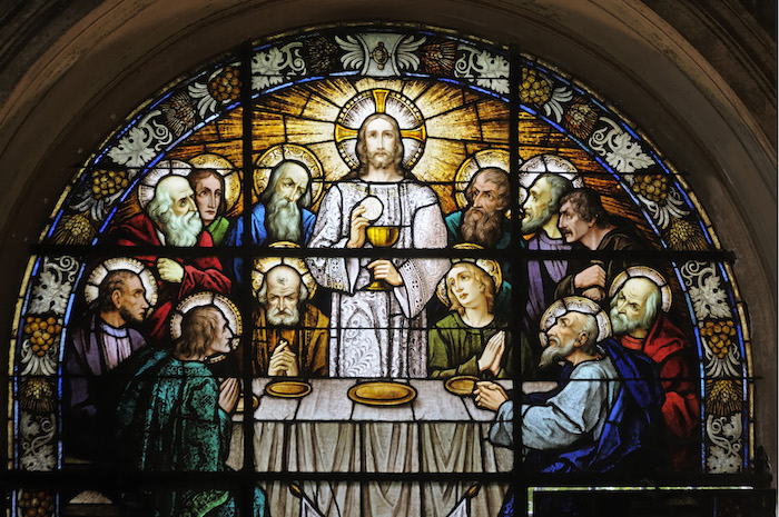 An ancient stained glass window of the Last Supper - the last meal Jesus Christ shared with his closest followers just before his death. ©Getty Images