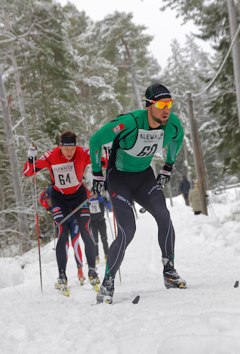 Cross-country skiers in a forest. © istock/Getty Images