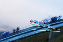 Ski jumping athletes 'fly' down the ski slope. © iStock/Getty Images