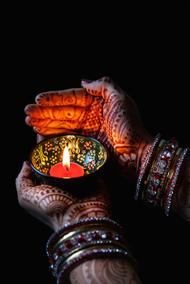 Hands painted with henna designs. The paint is made from the root of of the henna plant.  ©iStock
