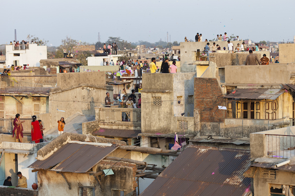 People crowd onto the rooftops to fly or watch kites. Photo ©Getty