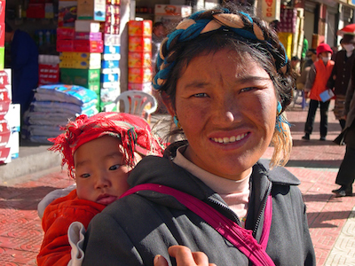 In Tibet, babies are often carried on their mother's back in a special sling.
