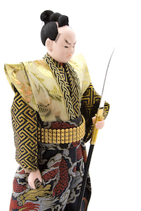 This doll is a Samurai, a soldier of many hundreds of years ago.