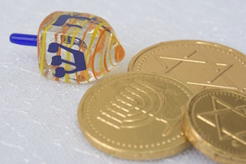 A dreidel and special chocolate coins