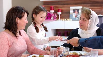 Family celebration lunch at Grandmother's house. Image©iStock