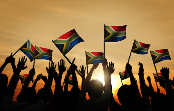The flag of South Africa was adopted on 27 April 1994. The black, green and yellow are from the banners of the three black organisations and represent the black citizens of the country. The red, white and blue are from the Dutch and British flags and represent the white citizens of the country. The Y shape represents the unification of all ethnic groups as coming into one path so past and present join and lead into the future.