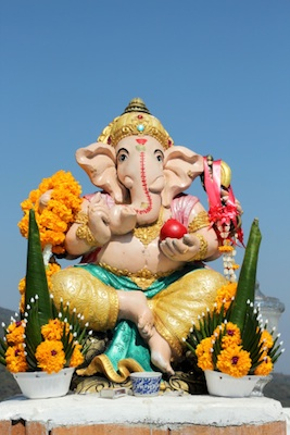 Offerings made in a temple or shrine include food and flower arrangements. This is Ganesh, the elephant-headed god of success and education. Image©iStock