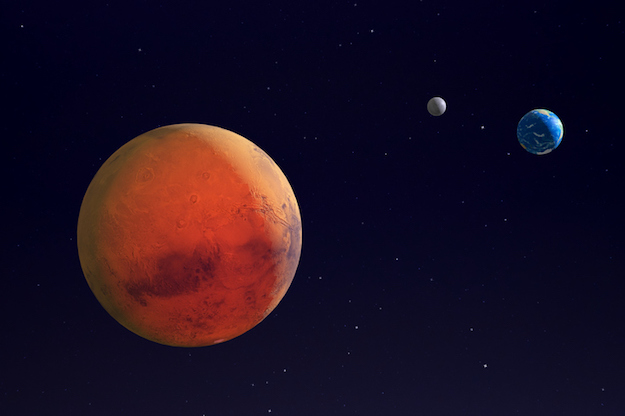 Mars, with Earth and Earth's moon. © iStock