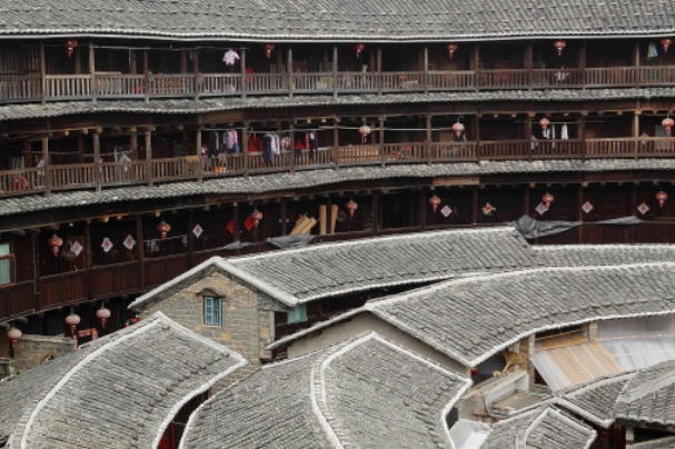 Apartments are built around the inside wall of the tulou. Getty Images