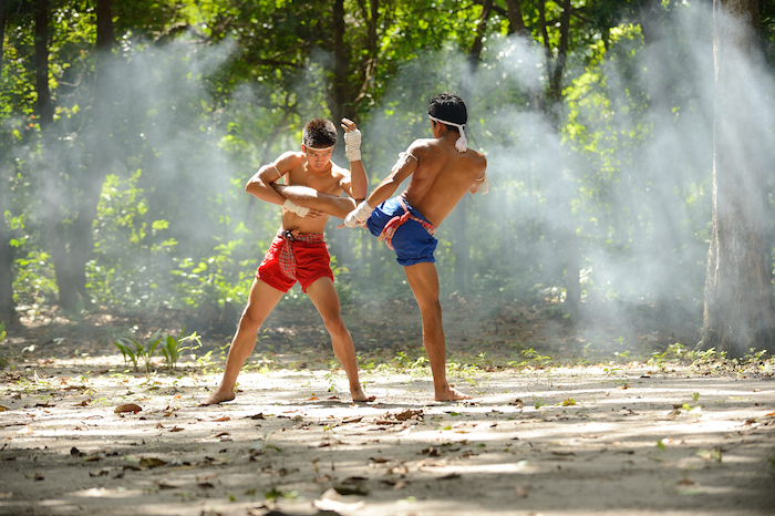 Muay Thai is also called 'kick boxing'. These Thai men are training. ©Getty