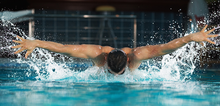 Butterfly swimmers lift both arms out of the water ©Getty