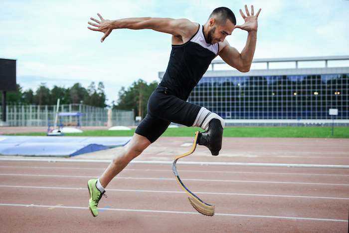 A sprinter bursts out of the blocks and down the track. The special artificial leg for running is called a prosthesis. ©Getty