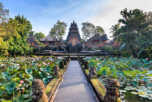 There are many Hindi temples. Lotus grow in the water garden in front of this temple in Ubub © iStock