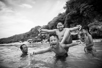 Balinese kids have fun at the beach. There are many fine beaches surrounding Bali ©iStock