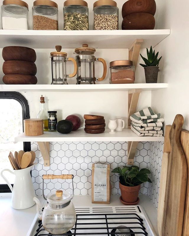 My simple little kitchen 🌟  Living tiny means messes look a whole lot bigger and worse than they are, but it just takes a few minutes to get things looking spiffy again.  I love @arrowsandbow philosophy on open shelving. Take it all down and have a good look at it. If you would not put any of those items in your cart right now to purchase again, then get rid of it.  I love each item on my shelves and everything has a purpose. If it doesn't, 👋🏽 P.s. do you spot the Cacao? Healthy hot chocolate recipe video coming at you soon