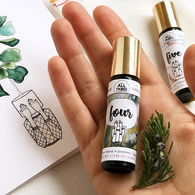 "🌿Enneagram perfumes!🌿 when I saw these botanical creations from @alltribesapothecary I knew I must have one. Britney has expertly and thoughtfully blended natural botanical fragrances to create a sensory scent for each enneagram type. It is no surprise that I am in love with the aroma of four. The four is a dark, complex scent full of earthy notes and florals. It's mysterious and romantic - just like us :-) I also have the 5 to layer for fun since I am a 4w5😆 Each roller is a different gemstone ✨ check out my stories for more details on these beauties!  I should also note that these are completely natural, of course. Conventional perfumes are so very toxic and should not be applied topically. Anything placed on the skin is absorbed into your blood stream within seconds. (Lotion, nail polish, perfume, the list goes on..) Perfumes made with pure essential oils and botanical elements are not just the ""natural"" alternative to synthetic perfumes. They are their own category; a unique type of scent made with the same elements used in perfumes for thousands of years. Unlike synthetic fragrances that are created in labs to be pleasing to the modern nose (sugary sweet and powdery fresh), essential oils are completely true to their origin. They never lose the hint of earthiness – their whisper of having come from the earth. They are also not laced with additives or mixed into alcohols to enhance and extend the scent, so they must be reapplied every few hours."