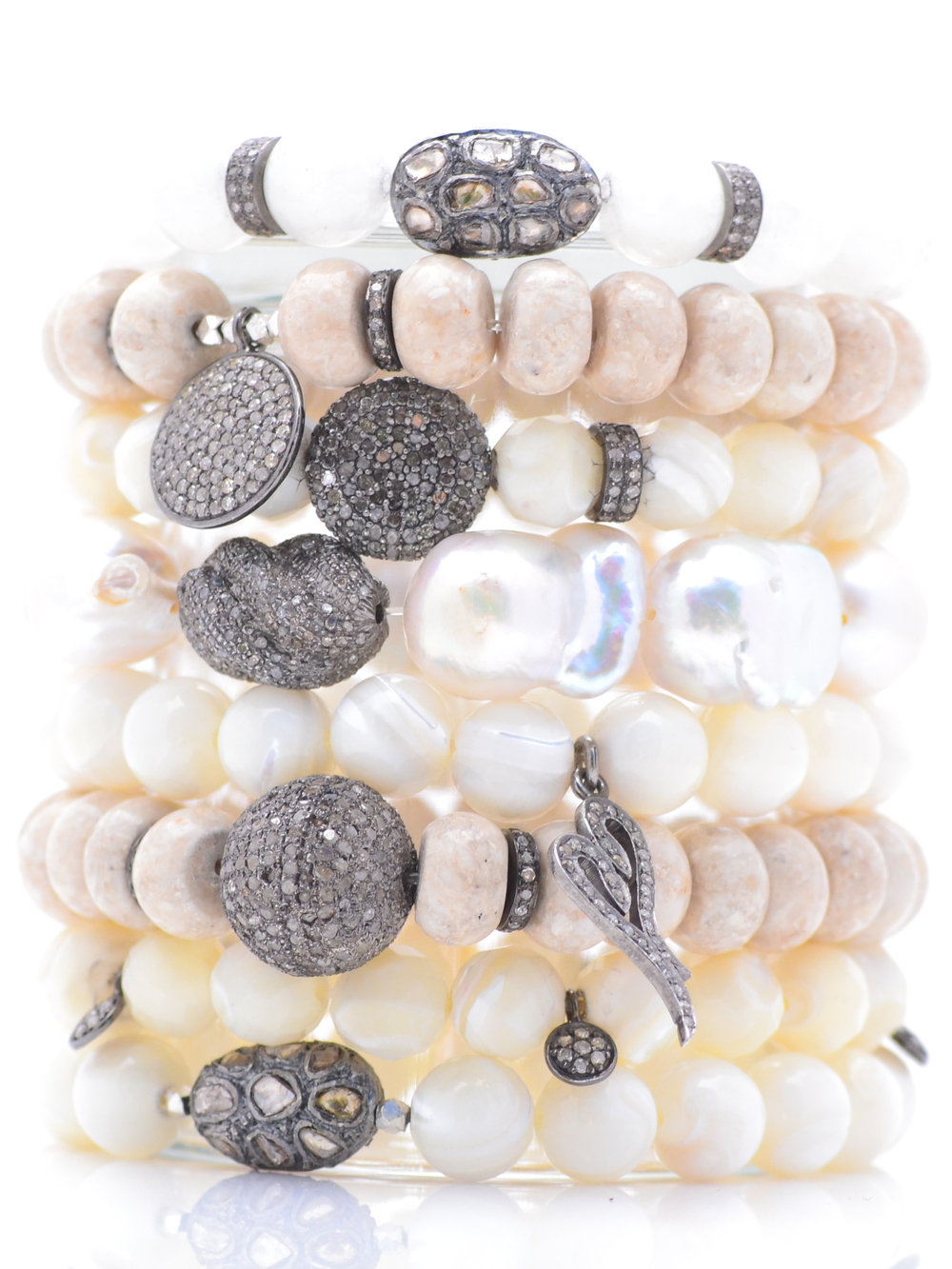 Mother of pearl, riverstone, moonstone and diamond bracelets set with diamond charms.