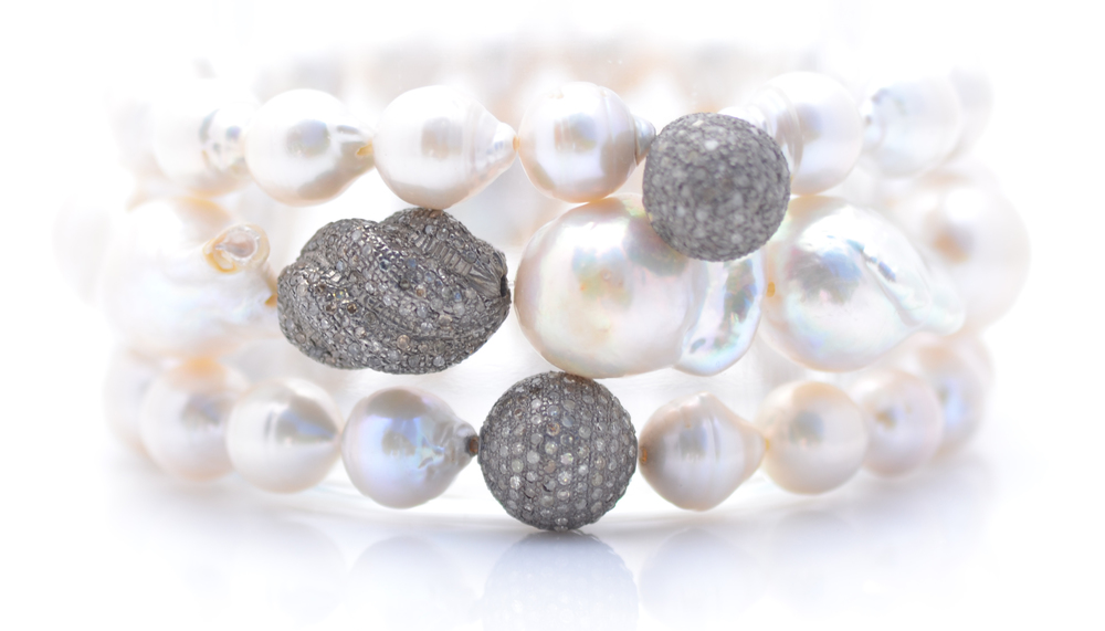 White baroque pearl & diamond bracelets.