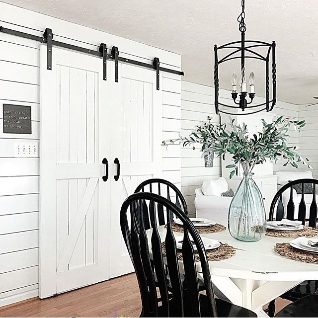 I am in love with barn doors, and this one from @themodestfarmhouse is gorgeous! The neutral tones with hints of green and iron are a classic match! . . . #designinspiration #barndoor #farmhouse #designideas #homeinspo #rustic #charm #brightwhite #natural #neutral #diningroom #interior #home