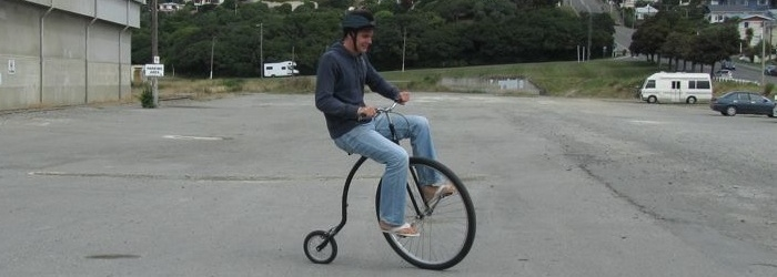 Riding an old school Penny-Farthing bicycle